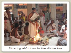 Offering ablutions to the divine fire