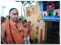 His Holiness walking past the Elliamman Temple - the guardian deity